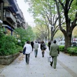 Commuters walking near apartments