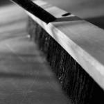 Clean sweep - close-up of broom - black & white