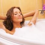 Woman relaxing in warm bubble bath