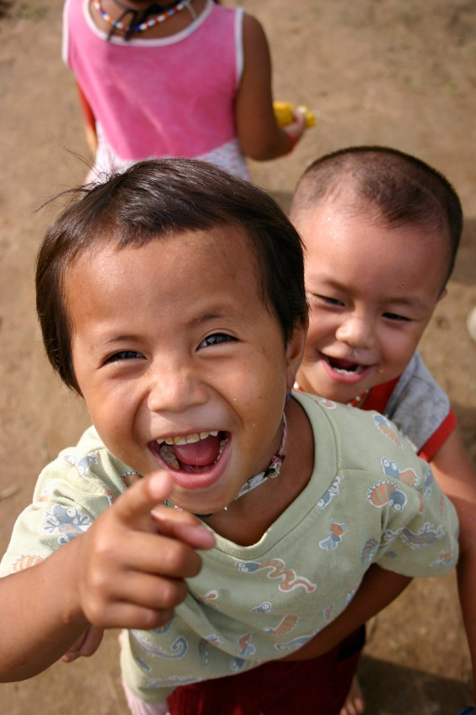 Asian hill tribe chidren laughing at photographer