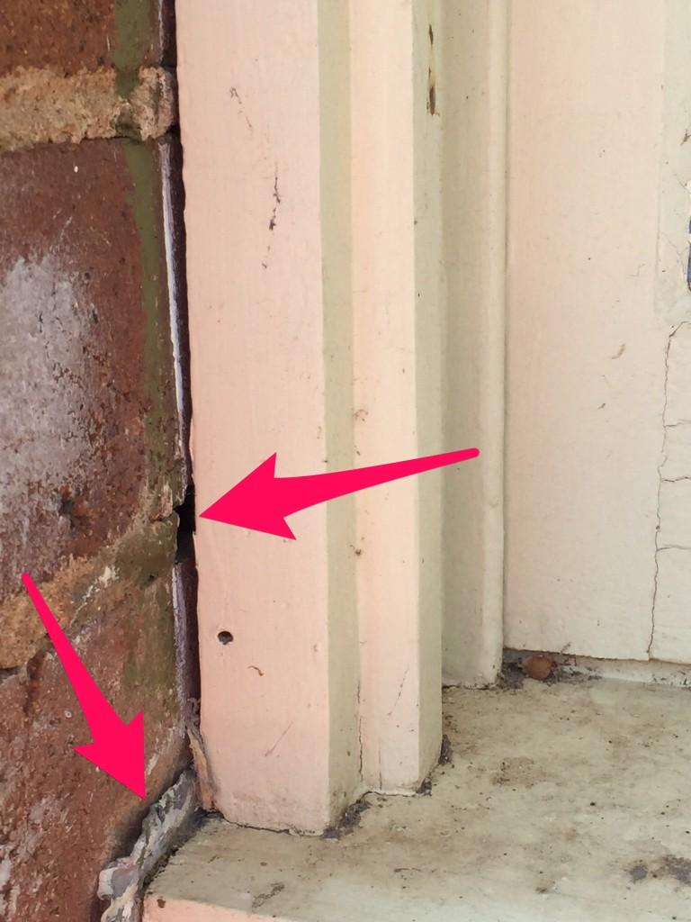 House - gap beside window frame - external - arrows